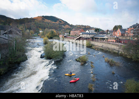 High angle view of two kayakers at the edge  of River Dee rapids, Llangollen, North Wales - Stock Photo