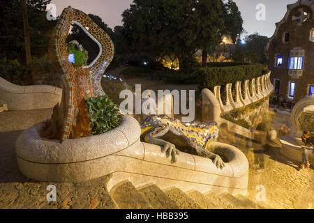 Spain, Barcelona, Park Guell at night, The Dragon fountain, mosaic covered salamander - Stock Photo