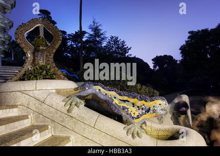 Spain, Barcelona, Park Guell at night, The Dragon Fountain, mosaic covered salamander, Gaudi design - Stock Photo
