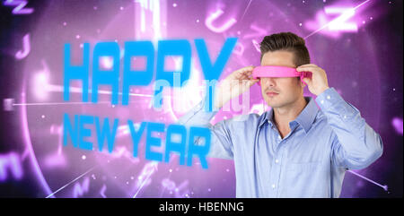 Composite image of man using pink virtual video glasses - Stock Photo