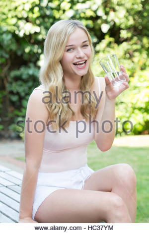 Young woman drinking glass of water. - Stock Photo