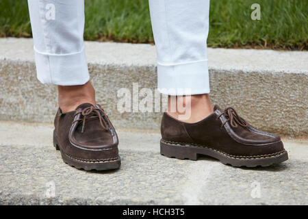 Man with brown shoes before Giorgio Armani fashion show, Milan Fashion Week street style on September 23, 2016 in - Stock Photo