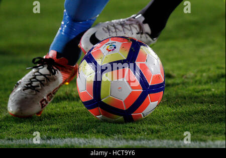 Detail of the feet of a soccer player running with the ball - Stock Photo