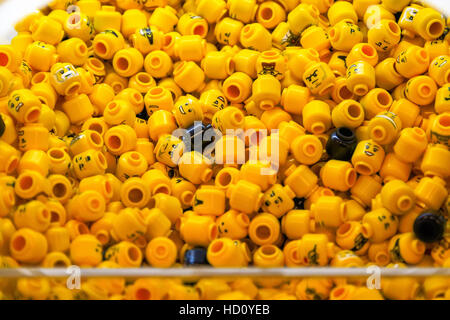 London, UK - November 22, 2016 - Pile of LEGO minifigure head parts - Stock Photo