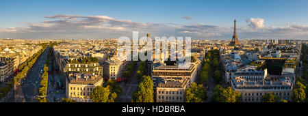 Panoramic view of rooftops and Avenues of Paris at sunset in summer. From left to right: Champs Elysées, Avenue - Stock Photo