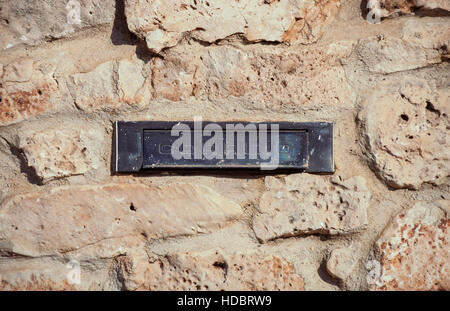 Letter box on stone wall. Portugal - Stock Photo