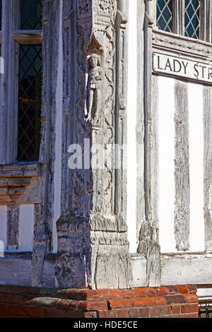 Carved, weathered oak corner of the Guildhall of Corpus Christi, Lavenham, Suffolk,England. - Stock Photo