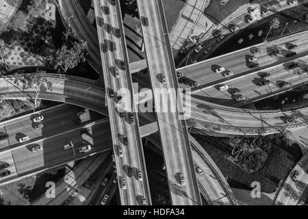Black and white aerial view downtown four level interchange of the Harbor, Pasadena and Hollywood Freeways. - Stock Photo