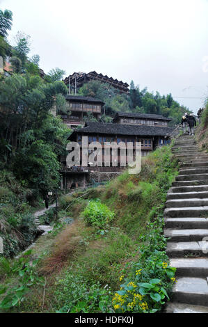 There are 1,000 steps up the mountain side to reach the summit and view the Longji rice terraces in Guilin Province. - Stock Photo