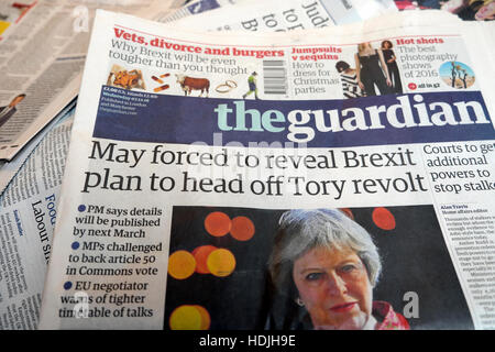 May forced to reveal Brexit plan to head off Tory revolt' Guardian newspaper headlines front page article 2016 London - Stock Photo