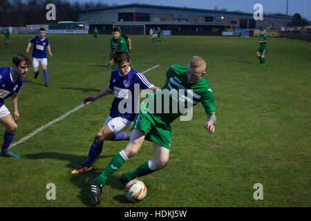 Second-half action at the Delta Taxis Stadium, Bootle, Merseyside as City of Liverpool (in purple) hosted Holker - Stock Photo