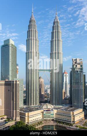 Famous Petronas Towers in Kuala Lumpur, Malaysia - Stock Photo