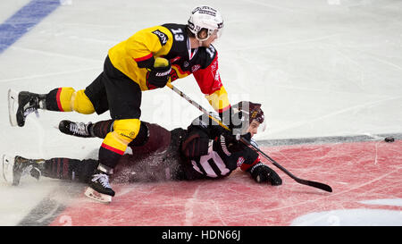Prague, Czech Republic. 13th Dec, 2016. From left: Luca Hischier of Bern and Martin Gernat of Sparta in action during - Stock Photo