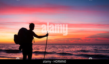Hiker on remote Guigui (or Guyguy) beach on the west coast of Gran Canaria at sunset - Stock Photo