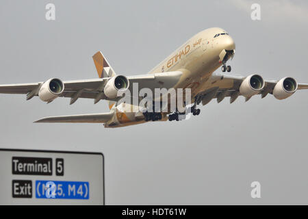 Etihad Airways Airbus A380-800 departing from London Heathrow Airport, UK - Stock Photo