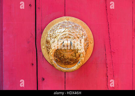 Traditional Chinese Door Knob on the gate of a temple in China Stock ...