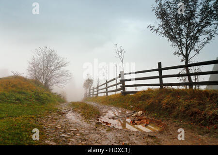 Muddy ground after rain in Carpathian mountains. Extreme path rural dirt road in the hills. Bad weather. - Stock Photo