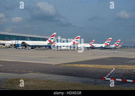 British Airways aircraft fleet parked outside terminal 2 at Heathrow Airport London UK  SCO 11,273. - Stock Photo