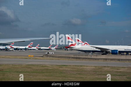 British Airways aircraft fleet parked outside terminal 2 at Heathrow Airport London UK  SCO 11,274. - Stock Photo