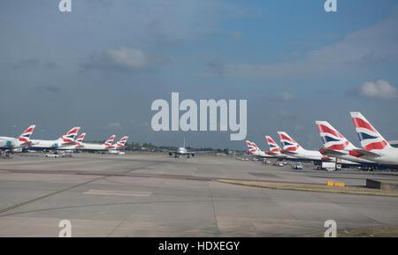 British Airways aircraft fleet parked outside terminal 2 at Heathrow Airport London UK  SCO 11,276. - Stock Photo