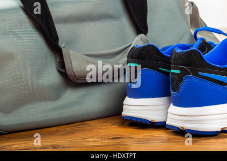 Sport bag on the wooden floor - Stock Photo