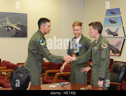 Lt. Col. Chris Keithley from left, 416th Flight Test Squadron commander, thanks F-16 pilot trainee Ocho and Maj. - Stock Photo