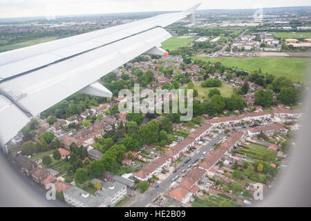 Plane about to land at Heathrow Airport. Flight from Paris to Heathrow,London.Flying over central London to Heathrow - Stock Photo