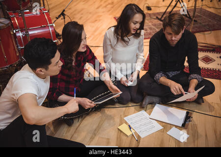 Team of musician composing tune in recording studio - Stock Photo