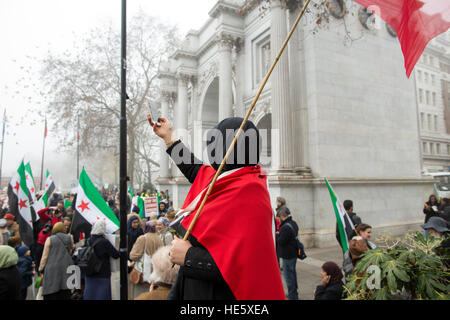 London, UK. 17th Dec, 2016. A protestor takes a selfie at the save Aleppo march, Marble Arch - 17/12/2016 © Edward - Stock Photo