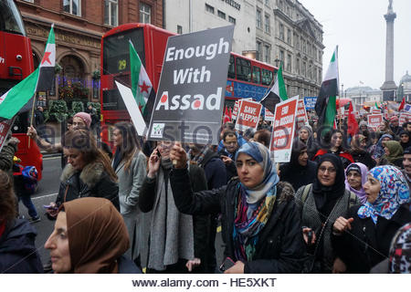 London, Uk. 17th Dec, 2016. Signs are held up as hundreds of Syrians and people standing in solidarity with them - Stock Photo