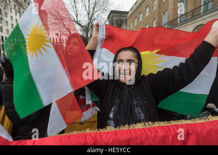 London, UK. 17th Dec, 2016. Kurds, many wearing or waving the Free Kurdistan flag, protest opposite Downing St calling - Stock Photo