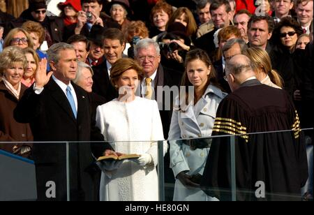 U.S. President George W. Bush stands by his family as he is sworn in during his second inauguration by U.S. Supreme - Stock Photo
