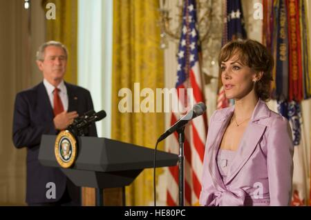U.S. President George W. Bush stands while the National Anthem is sung during the opening of the Presidents Volunteer - Stock Photo