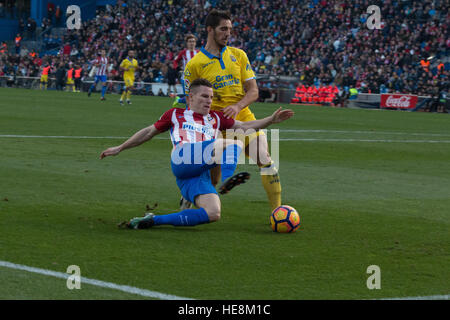 Madrid, Spain. 17th Dec, 2016. Gameiro (L) try to shoot to goal over the presence of Bigas (R). Atletico de Madrid - Stock Photo