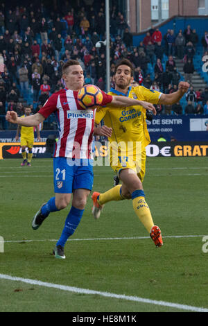 Madrid, Spain. 17th Dec, 2016. Gameiro (L) try to control the ball over the pressure of Bigas (R). Atletico de Madrid - Stock Photo