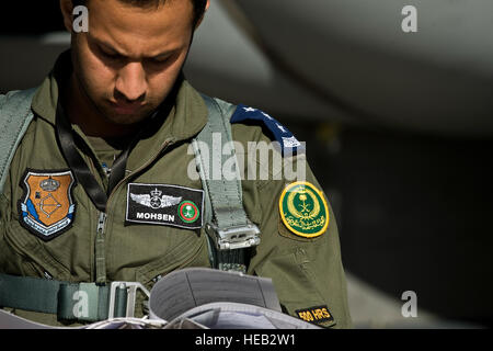 Royal Saudi Air Force Capt. Mohsen, F-15 Strike Eagle pilot looks over a flight log before a training mission during - Stock Photo