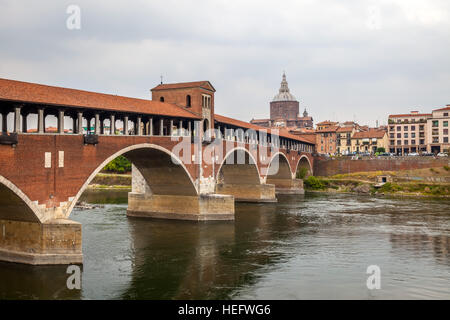 View of the Old Bridge (Ponte Vecchio) and the Dome in Pavia. - Stock Photo