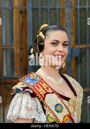 Las Fallas Spanish girl wearing Fallera traditional costume in Valencia Spain. - Stock Photo