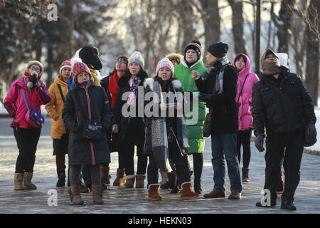 Moscow, Russia. 22nd Dec, 2016. Asian tourists visit the Moscow Kremlin. © Sergei Fadeichev/TASS/Alamy Live News - Stock Photo