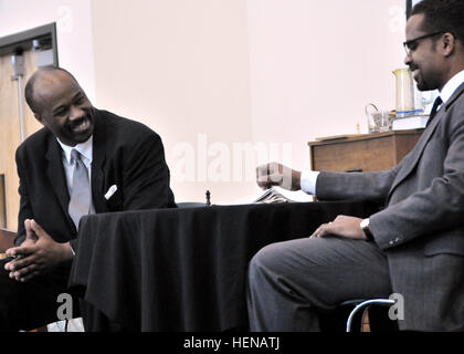 Martin Luther King Jr. (Kelvin Wade) shares a joke with Malcolm X (Masaud Olufani) during a Jan. 22 performance - Stock Photo