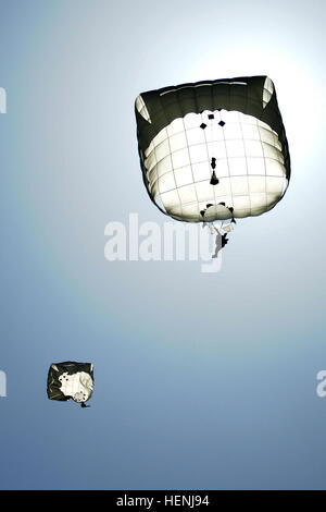 U.S. Army paratroopers with the 173rd Airborne Brigade Combat Team parachute during an event commemorating the 70th - Stock Photo