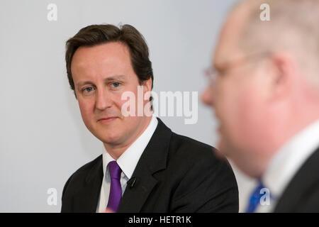 David Cameron looking at Eric Pickles - Stock Photo