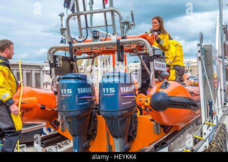 The RNLI in action in a rescue at Newquay Harbour in 2015 - Stock Photo