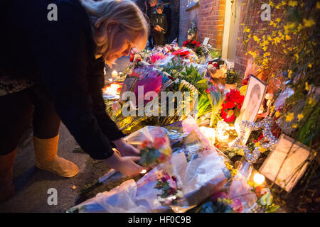 Goring, UK. 26th Dec, 21016.  Flowers, candles and words of sympathy were left outside George Michael's home in - Stock Photo