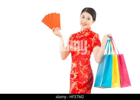 Asian woman wearing cheongsam dress, holding angpao and shopping bag. Happy chinese new year concept. isolated on - Stock Photo