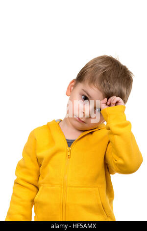 Cute schoolboy thinking idea while wearing glasses and looking at up, isolated - Stock Photo