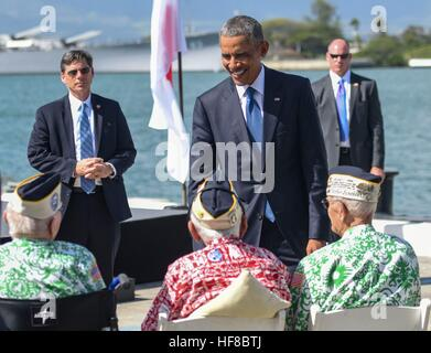 Pearl Harbour, Hawaii. 27th Dec, 2016. U.S President Barack Obama greets survivors of the attack on Pearl Harbor - Stock Photo