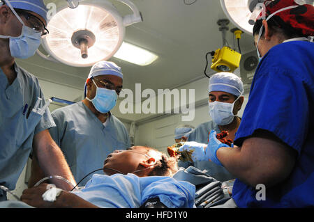 From left, U.S. Navy surgeon Cmdr. Jerry Berman, Dr. Henri R. Ford, the surgeon in chief of Los Angles Pediatric - Stock Photo