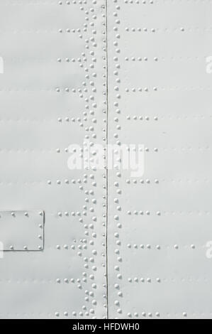 texture of the white metal plates with rivets - Stock Photo