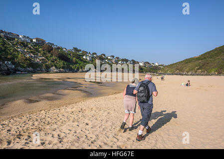 Two walkers on the award winning Crantock Beach in Newquay, Cornwall, England, UK. - Stock Photo